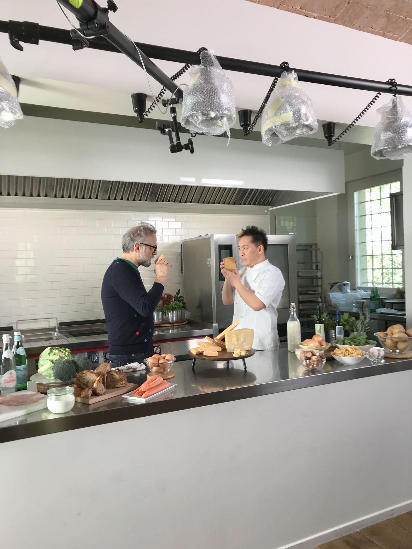 Chef Takahiko Kondo talking with Massimo Bottura